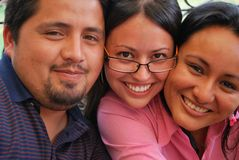 Faces of Young Hispanic friends Royalty Free Stock Photo