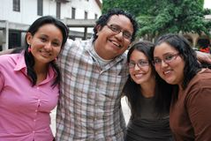 Faces of Young Hispanic friends. Faces of young Hispanic university students enjoying time together Royalty Free Stock Photography