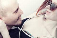 Faces of a young kissing man and woman Royalty Free Stock Photos