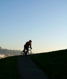 facet na rowerze sylwetki Zdjęcia Royalty Free