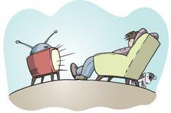 facet patrzy leniwy tv Fotografia Stock