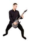 Facet w czerni ubraniach bawić się gitarę Fotografia Royalty Free