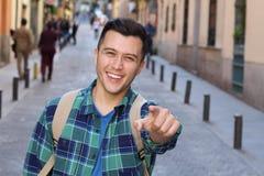 Facet wskazuje z ono uśmiecha się i palcem zdjęcia royalty free