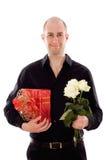 Facet z różami i prezenta pudełkiem Fotografia Royalty Free