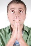 faceta przystojny modlenia niebo potomstwa Zdjęcia Stock