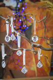 Faceted crystal Christmas decorations on a tree Stock Image