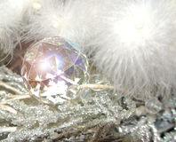 Faceted crystal ornament on a white feather tree Stock Photography
