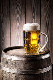 Faceted glass of light beer with a thick foam Royalty Free Stock Image
