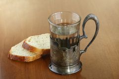 A faceted glass of water in an ancient silver cup holder Royalty Free Stock Photos