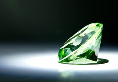Faceted Green Gemstone. Faceted round cut green gemstone painted with light Royalty Free Stock Photos