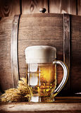 Faceted mug of light beer Royalty Free Stock Image