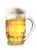 Faceted mug of light beer with foam Stock Photos