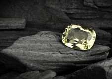 Faceted yellow jewelry gemstone on darck background Stock Image