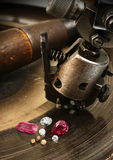 Faceting gemston, big diamond with jewelery equipment on backgro