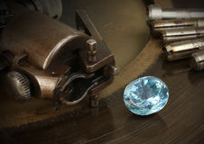 Faceting gemston, big diamond with jewelery equipment on backgro Royalty Free Stock Photography