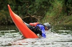 Facewash. Man performing stunts in a Kayak Stock Images