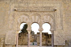 Fachada árabe. A facade of the ninth century unearthed, rebuilt and restored in the archaeological site of Medina Azahara in Cordoba, Spain with midday light Royalty Free Stock Images