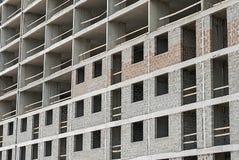 A fachada de uma construção sob a construção imagens de stock