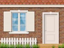 Fachada do tijolo com uma janela branca e uma porta ilustração stock