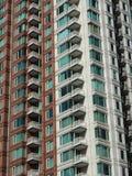 Fachada moderna da construção com janelas e balcões Imagens de Stock Royalty Free