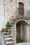 Fachada pitoresca de uma casa de pedra velha Imagem de Stock