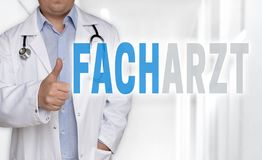 Facharzt in german Specialist concept and doctor with thumbs u. P stock photo