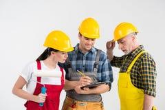 Fachowi pracownicy budowlani Zdjęcia Stock