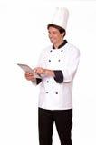 Fachowy męski szef kuchni pracuje na pastylka komputerze osobistym Zdjęcia Royalty Free