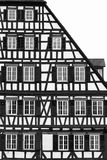 Fachwerk architecture style. Cropped facade of building made in  fachwerk or half-timber architecture style Royalty Free Stock Photo