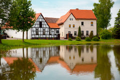 Fachwerk house. And reflection in pond Royalty Free Stock Images