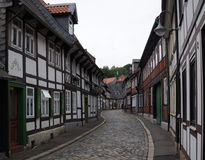 Fachwerk houses in Goslar Germany. Empty street with fachwerk houses in Goslar Germany Royalty Free Stock Photo