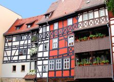 Fachwerk houses with flowerpots at the Merchants bridge, Erfurt, Germany. Colorful fachwerk houses at the Merchant Bridge Kraemerbruecke in Erfurt in Germany Royalty Free Stock Image