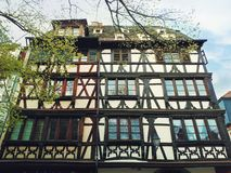 Fachwerk timber framed house in Colmar city, France, Alsace. Traditional architecture medieval home facade, historic town. Fachwerk timber framed house in stock photo