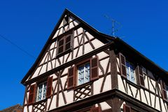 Fachwerkhaus, or timber framing house, in Colmar town, Alsace, France. On blue sky background royalty free stock photo