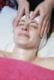 Facial. Woman having a facial treatment in beauty salon Stock Images
