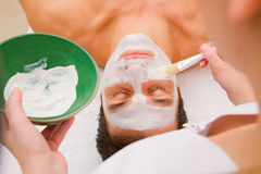 Facial beauty treatment by an aesthetician Stock Photos