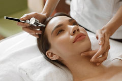 Free Facial Beauty Treatment. Woman Getting Oxygen Skin Peeling Stock Image - 75483701