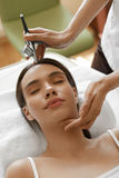 Facial Beauty Treatment. Woman Getting Oxygen Skin Peeling Royalty Free Stock Photos