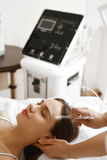 Facial Beauty Treatment. Woman Getting Oxygen Water Skin Peeling Royalty Free Stock Photography