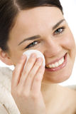 Facial care. Young woman taking care about her face holding a cotton pad Stock Photos