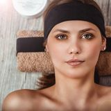 Facial care. Spa. Beauty saloon. Portrait of a beautiful young smiling woman Stock Image