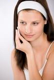 Facial care - woman removing make-up Stock Photos