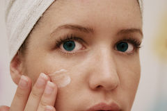Facial cleansing. Woman cleaning face with cream royalty free stock photos