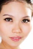 Facial closeup asian girl. Close up of a beautiful asian girl with beautiful catchlights Stock Images