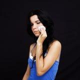Facial cream. Girl applying facial cream - isolated on black stock photo