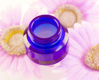 Facial cream and flowers Royalty Free Stock Photo