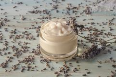 Facial cream of homemade lavender in a glass jar stock images