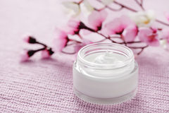 Facial cream. Jar of facial cream - beauty treatment Royalty Free Stock Image
