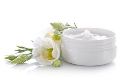 Facial cream. In white container with flowers Stock Photo