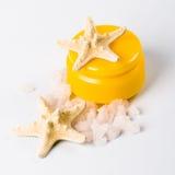 Facial creme, seasalt and seastar. Closeup Royalty Free Stock Photos